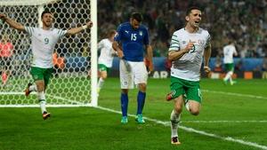 Robbie Brady wheels away in celebration
