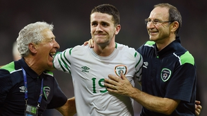 Robbie Brady is congratulated by Martin O'Neill (R) at the final whistle