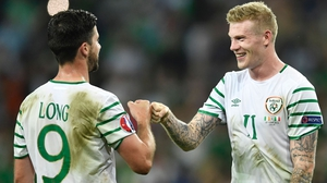 Shane Long (L) and James McClean relish the victory