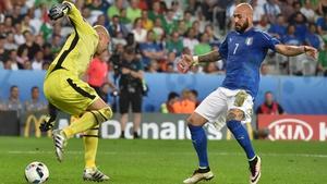 Darren Randolph twists away from Italy's Simone Zaza