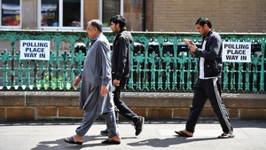Men walking into a primary school polling station in Glasgow