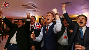 Leave EU supporters wave Union flags and cheer as the results come in at a party at Millbank Tower in central London