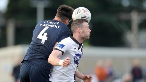 Dundalk goalscorer Ciaran Kilduff is challenged by Darren Dennehy