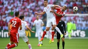 Arkadiusz Milik of Poland and Valon Behrami of Switzerland compete for the bal