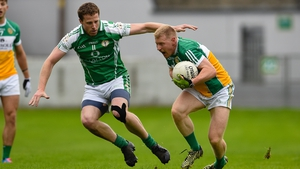 London's Mark Gottsche and Niall Darby of Offaly in action in Tullamore