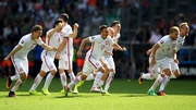 Poland players celebrate after Grzegorz Krychowiak fires then into the quarter-finals