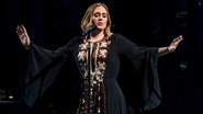 Rolling in the mud: Adele wows Glastonbury