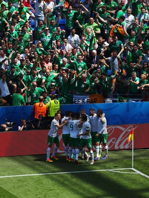The Irish players celebrate in front of their supporters