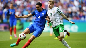 France's Adil Rami and James McClean fight for the ball