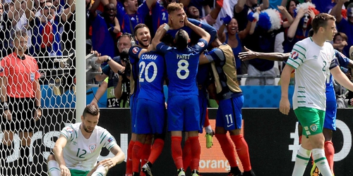 France players celebrate with Antoine Griezmann after he scored his second goal against the Boys in Green