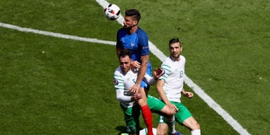 Giroud rises above Ireland's centre halves to help set up France's second goal