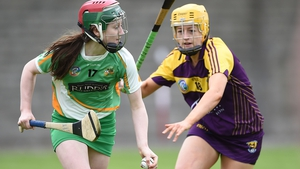Offaly's Sarah Harding with Louise O'Leary of Wexford