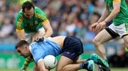 James McCarthy is tackled by Graham Reilly