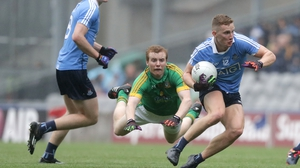 Ciaran Kilkenny avoids the despairing dive of Meath's Dalton McDonagh