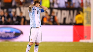 A dejected Lionel Messi looks on in the penalty shoot-out defeat to Chile