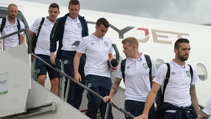 Ireland's players alight at Dublin after returning from France