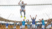 Gianluigi Buffon hangs from the crossbar as he and his team-mates celebrate their victory