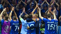 Iceland celebrate with their fans after a famous victory over England