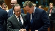 Francois Hollande and David Cameron chat in Brussels