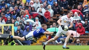 Tyrone's Colm Cavanagh gets away from James McEnroe in the drawn game