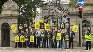 Members of the GRA protest outside Leinster House