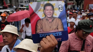 Activists march in Manila to show support for Rodrigo Duterte