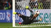Rui Patricio of Portugal saves a penalty by Jakub Blaszczykowsk
