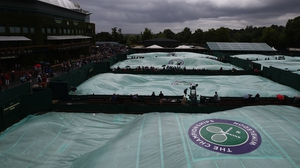 The familiar sight of the Wimbledon covers greeted fans at SW19 again today