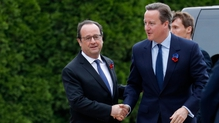 Francois Hollande greets David Cameron at the Battle of Somme commemoration ceremony in France