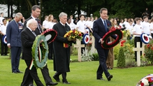 President Higgins, Sir Tim Laurence, former German president Horst Kohler and British Prime Minister David Cameron lay wreaths