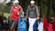 McIlroy and caddie JP Fitzgerald look on during the second round at the French Open