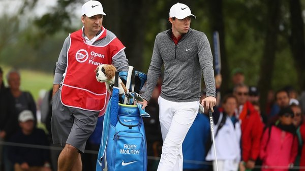 fb7dd0a78cf1 McIlroy and caddie JP Fitzgerald look on during the second round at the French  Open