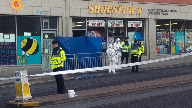 The man was shot up to four times by a gunman in the head and chest near the entrance to a shopon Bridgefoot Street