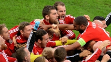Wales celebrate Ashley Williams' (R) equaliser