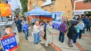 Voters queue outside a polling booth in Adelaide's suburb of Glynde, South Australia