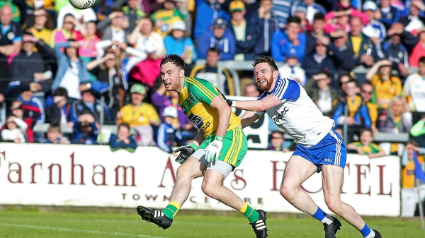 Donegal's Martin McElhinney with Monaghan's Owen Duffy