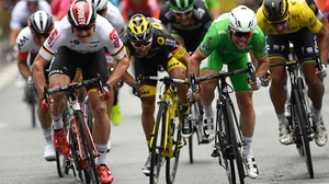Mark Cavendish (2nd R) crosses the finish line ahead of Germany's Andre Greipel (L), France's Bryan Coquard (2nd L) and Slovakia's Peter Sagan (R)