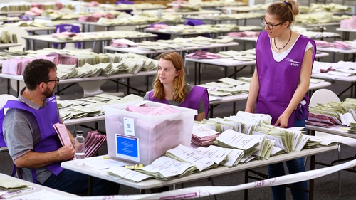 Australian Electoral Commission workers sort through absentee ballot papers in Sydney in 2016. Photo: Getty Images