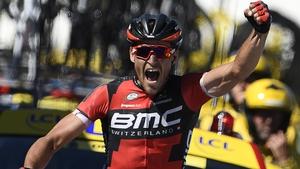 Greg van Avermaet celebrates as he crosses the finish line