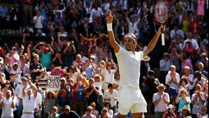 Roger Federer celebrates surviving a huge scare at Wimbledon