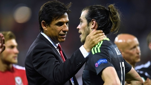 Wales manager Chris Coleman consoles Gareth Bale after the full-time whistle in Lyon