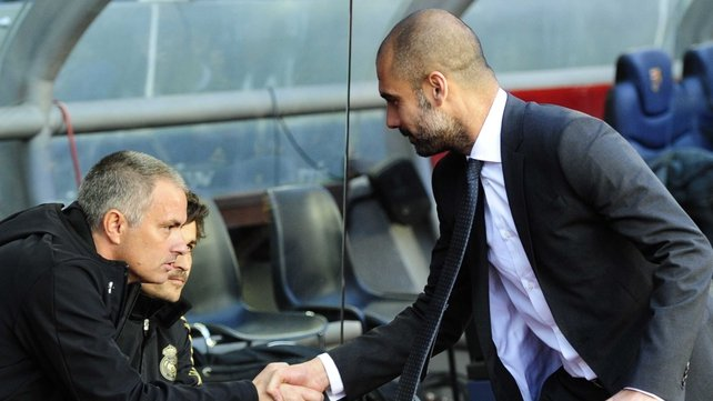 Guardiola (R) and Mourinho will renew their rivalry in Beijing