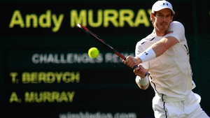 Andy Murray unleashes a crosscourt backhand winner in his victory over Tomas Berdych