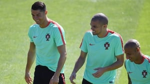 Pepe, centre, shares a joke with Cristiano Ronaldo during Portugal training on Saturday