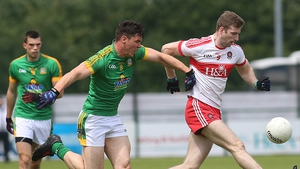 Derry's Brian Holly and Meath's Harry Rooney