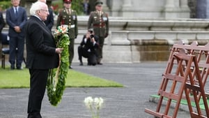 President Michael D Higgins lays a wreath at the Irish National War Memorial Gardens in Islandbridge, Dublin