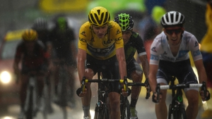 Froome crosses the line, just two seconds ahead of Ireland's Dan Martin