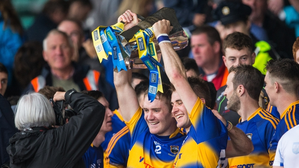 Brothers Noel and John McGrath lift the trophy