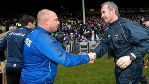 Derek McGrath shakes hands with Tipp boss Michael Ryan