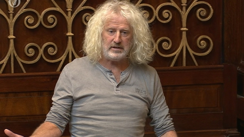'Life's too short to be worrying,' Mick Wallace told reporters outside court
